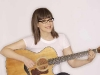 Lisa Loeb with her guitar