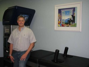 Dr. Randall Laurich shows off the incredible technology in chiropractic care, DRX 9000 machine.