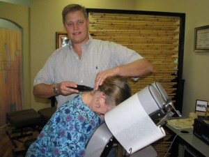 Dr. Laurich treats a patient using the Pro-Adjuster.