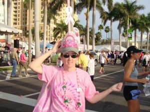 """Tracie Biery, a survivor, of team """"Life is Good"""" walks proudly with the 1st place plunger on her head - for best decorated Tickled Pink Potty."""