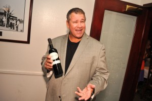 Paul Castronovo showing his brand of wine. Photo: Castronovo Vineyards.