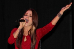 Wellington's Cassadee Pope (finalist on NBC's The Voice) singing on Clematis Street in West Palm Beach. Photo by Monica Kallas.