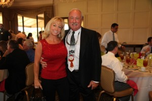 Dr. Jeffrey Bishop, Chair of the CPBC Chamber of Commerce, and his wife at the Dec. 3rd Chamber Luncheon. Photo by Carol Porter.