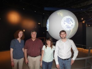 The Science on a Sphere exhibit and the team who installed it at the South Florida Science Center.
