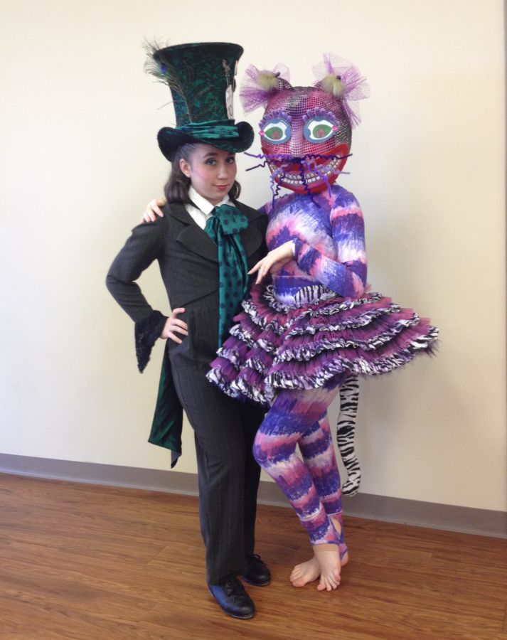 Emma Parssi (Wellington) as the tap-dancing Mad Hatter and Sydney Sheldon (WPB) as the Cheshire Cat