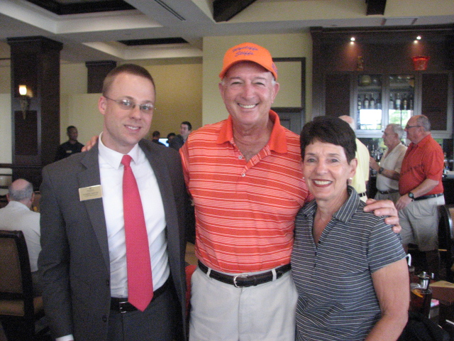"""Clubhouse Manager and Darrell's """"right hand man"""" Rob Martin with Wycliffe residents Marty and Harriet Ross."""